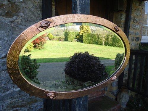 Arts & Crafts oval copper mirror