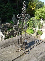 Arts & Crafts set of steel fire tools on stand