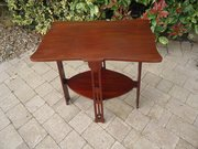 Arts & Crafts two tiered table in walnut