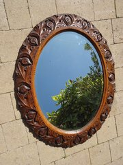 Beautifully carved Arts & Crafts oak mirror