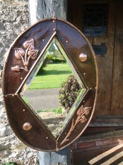 Dainty  Arts & Crafts copper mirror with leaves