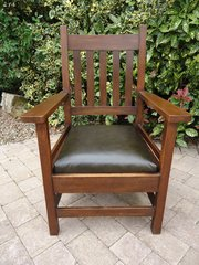 Large Arts & Crafts arm chair with leather seat.