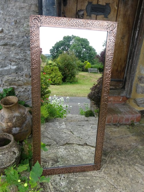 Large Arts & Crafts copper mirror. Overmantle