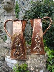 Pair of Arts & Crafts Glasgow school lidded jugs