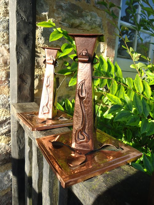 Pair of Arts & Crafts copper candlesticks