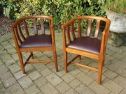 Pair of Arts & Crafts oak barrel back chairs