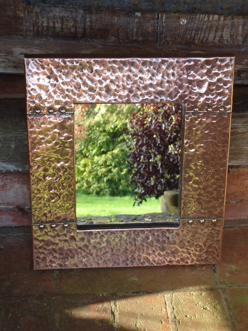 Small Arts & Crafts copper studded mirror