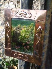 Stunning Arts & Crafts copper mirror with spades