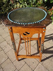 Unusual Arts & Crafts table with cabochons