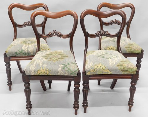 A Set Of Four Mahogany Balloon Back Dining Chairs