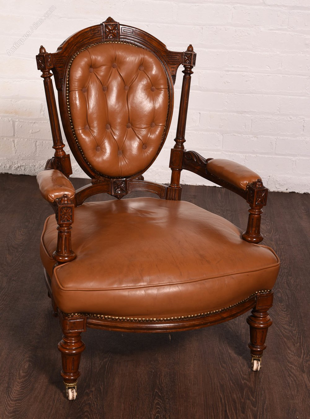 Victorian carved walnut leather button back chair