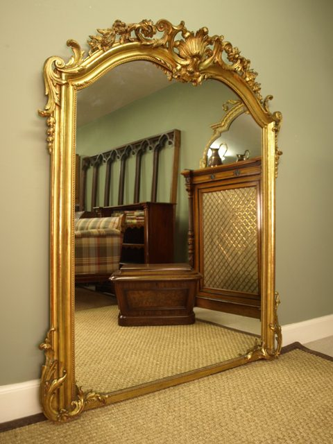 A Large Ornate Victorian Giltwood Mirror
