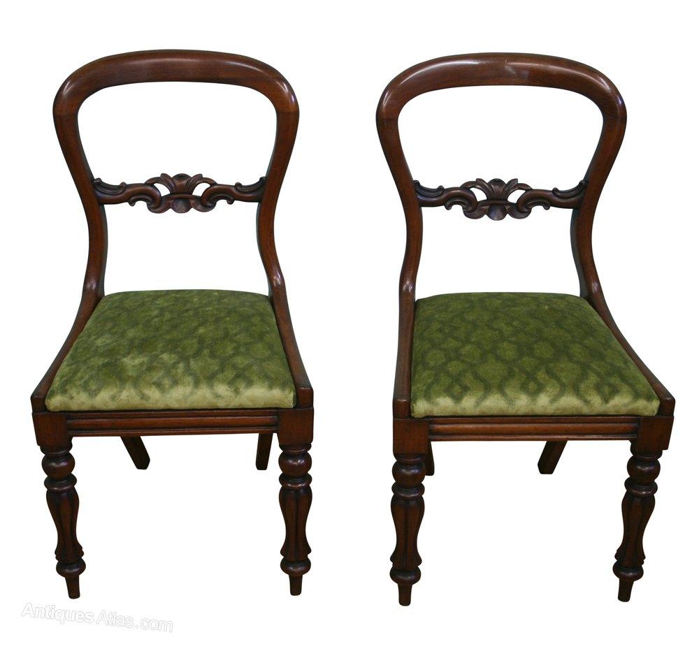 A Pair Of Victorian Mahogany Balloon Back Chairs